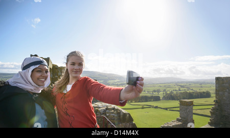 Students in period dress at castle - Stock Photo