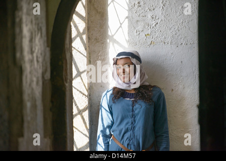 Student in period dress at castle - Stock Photo