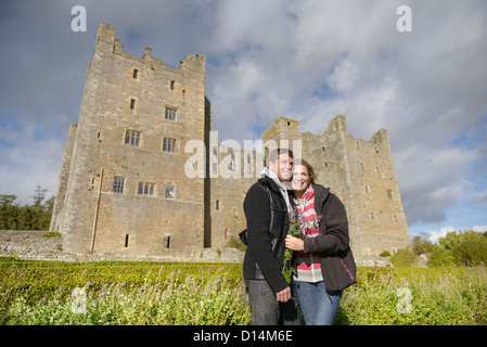 Couple hugging by medieval castle - Stock Photo