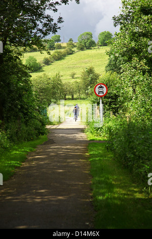 Two cyclists cycling the Manifold Way a footpath and cycle way in Staffordshire Peak District National Park England - Stock Photo