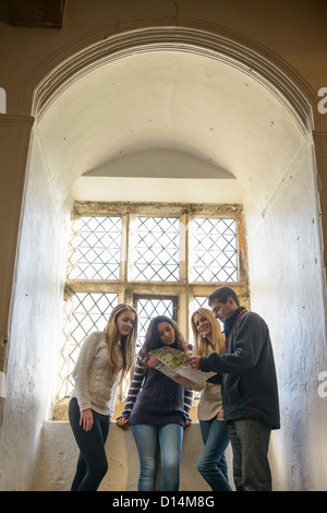 Students reading map in castle - Stock Photo