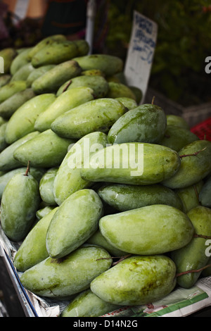 Green mango for sale at market - Stock Photo