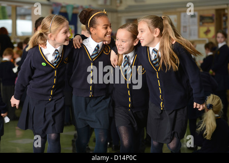 A group of friends leave morning assembly at Our Lady & St. Werburgh's Catholic Primary School in Newcastle-under - Stock Photo