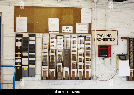 Time cards and clock in factory - Stock Photo