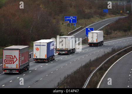Trucks traveling along the M20 motorway in Kent, England - Stock Photo