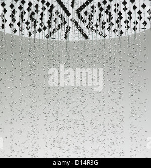 Water drops falling from shower head - Stock Photo