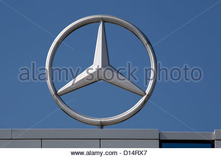 Mercedes benz badge symbol stock photo royalty free image for Mercedes benz stock symbol