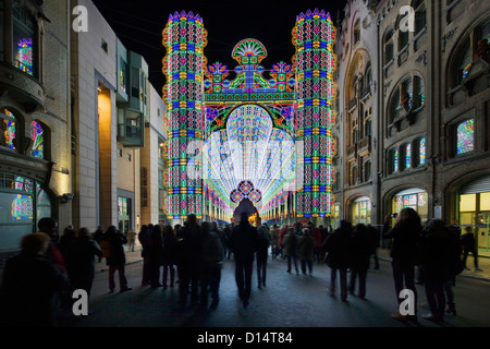 Colourful illuminated arch at the Festival of Lights / Light Festival in the city Ghent at night, Belgium - Stock Photo