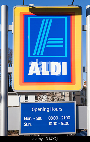 Aldi supermarket sign with opening hours, Abergavenny, Wales, UK