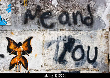 Urban graffiti street art message on wall of abandoned house Lisbon Portugal Europe - Stock Photo