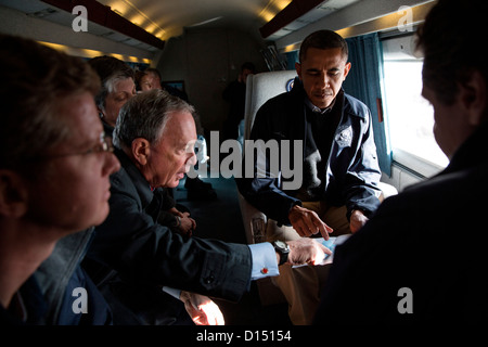 New York Mayor Michael Bloomberg points out areas on a map for President Barack Obama aboard Marine One during an - Stock Photo