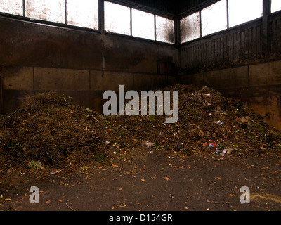 Pile of household biological waste contaminated with plastic material in waste processing plant in Rijsenhout, the Netherlands Stock Photo