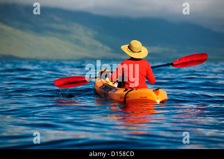 Hawaii, Maui, Kayakers On The South Coast Of Maui. - Stock Photo