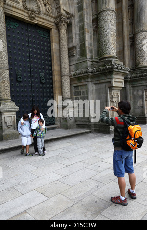 Man taking photo of his family in front of main entrance on west facade of cathedral , Santiago de Compostela, Galicia, - Stock Photo
