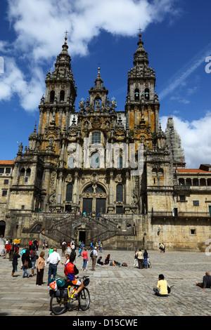 Tourists in Praza do Obradoiro and west facade of cathedral , Santiago de Compostela , Galicia , Spain - Stock Photo