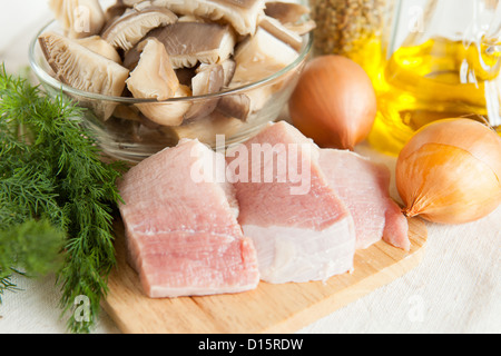 two pieces of raw meat and vegetables, close up - Stock Photo