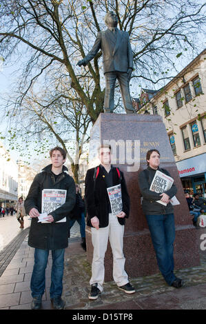 8th December 2012. Cardiff, UK. Activists stand by a statue of Aneurin Bevan the founder of the British NHS. UK - Stock Photo