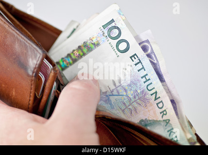A bulging wallet filled with swedish money