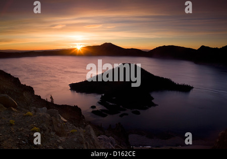 OR00523-00....OREGON - Sunrise over Crater Lake and Wizard Island from the Watchman Overlook in Crater Lake National - Stock Photo