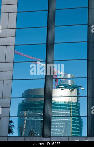 Titania tower reflected on glass facade. AZCA, Madrid, Spain. - Stock Photo