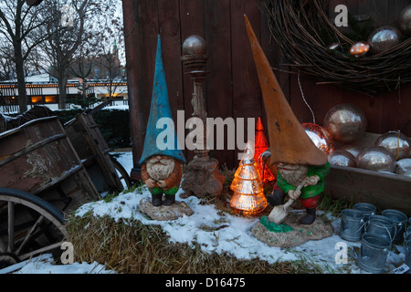 Old garden gnomes or rather brownies associated with the Nordic Christmas in winter landscape at the Tivoli Christmas - Stock Photo