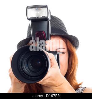 Close up of female photojournalist holding camera, isolated on white background. - Stock Photo