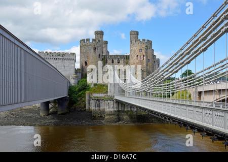 Robert Stephenson tubular railway bridge and Thomas Telford suspension bridge crossing River Conwy - Stock Photo