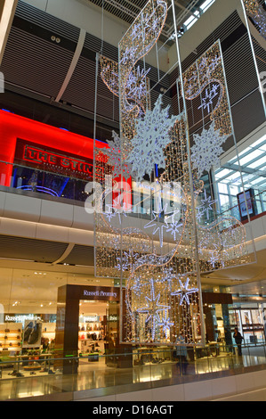 Westfield shopping malls decorated for Christmas seen early morning Stratford City Newham East London England UK - Stock Photo