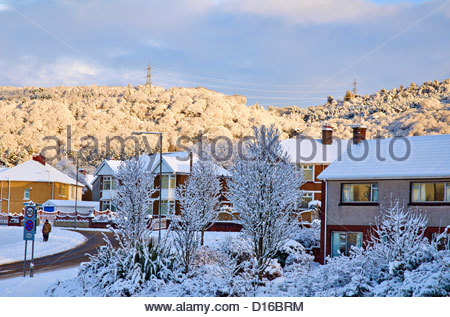 snow covered roof tops on a council housing estate - Stock Photo