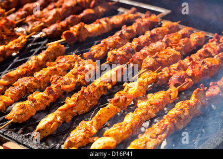 Barbecued sticks with chicken meat - Stock Photo