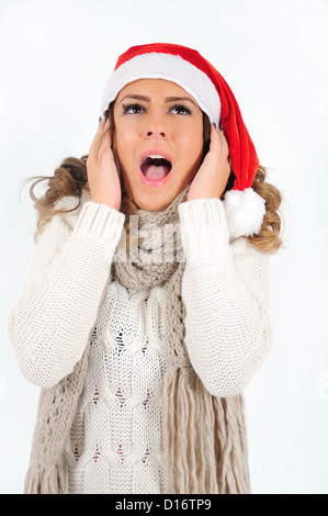 Young girl in christmas suit scream - Stock Photo