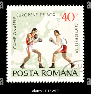 Postage stamp from Romania depicting boxers. - Stock Photo