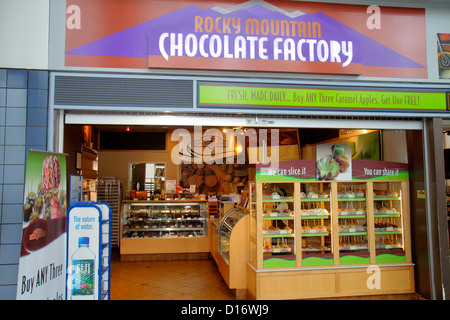 Chicago Illinois O'Hare International Airport ORD concourse gate area Rocky Mountain Chocolate Factory business - Stock Photo