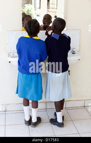Children supported by WOFAK (Women Fighting Aids in Kenya) OVC (orphans & vulnerable children) feeding program - Stock Photo