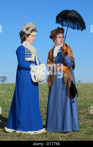 Two beautiful ladies in 19th-century attire in Jena, Germany - Stock Photo