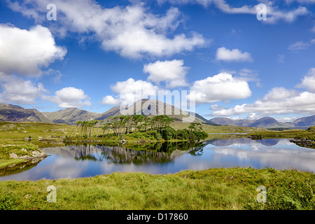 A mountainous landscape reflected in Derryclare Lough, in the Inagh Valley, County Galway, Ireland. - Stock Photo