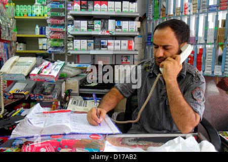 Dubai UAE United Arab Emirates U.A.E. Middle East Deira Al Muraqqabat grocery store Middle Eastern man manager owner - Stock Photo