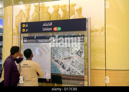 Dubai UAE United Arab Emirates U.A.E. Middle East Deira Al Rigga Union Metro Station Red Green Line subway public - Stock Photo