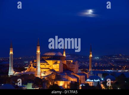 Night lights on Hagia Sophia under a full moon at twilight in Istanbul Turkey - Stock Photo