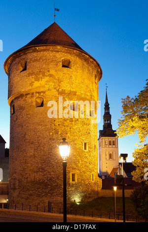 Medieval city wall lit up at night - Stock Photo