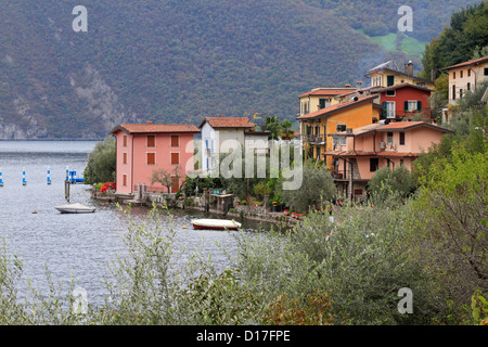 Colourful houses in Monte Isola on Lake Iseo, near Bergamo, Lombardy, Italy, Europe. - Stock Photo