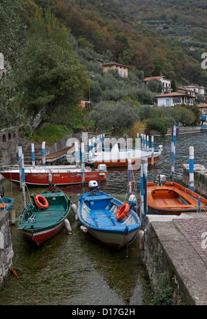 Boats in a small harbour in Monte Isola on Lake Iseo near Bergamo, Lombardy, Italy, Europe. - Stock Photo