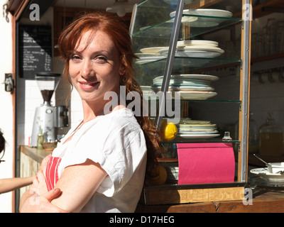 Woman working at sidewalk cafe - Stock Photo