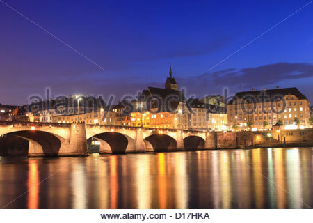 City lights reflected in river - Stock Photo