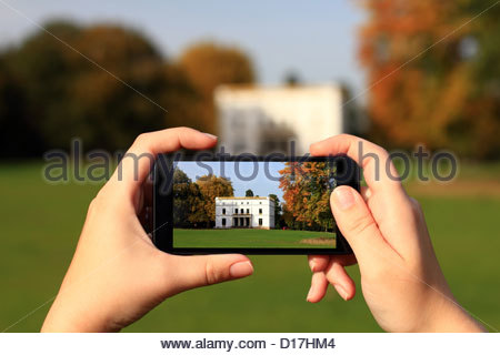 Hands taking picture with cell phone - Stock Photo