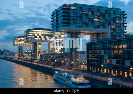 Evening view of modern crane-houses at Rheinauhafen mixed residential and commercial property development on River - Stock Photo