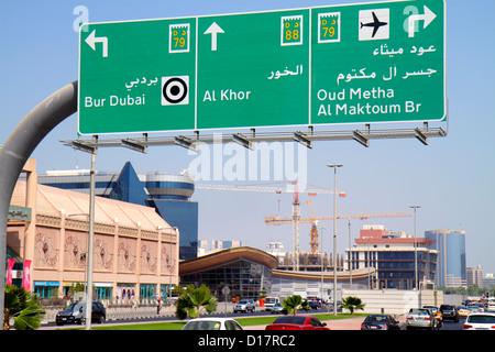 Dubai UAE United Arab Emirates U.A.E. Middle East Sheikh Khalifa bin Zayed Road Burjuman Shopping Centre sign directions - Stock Photo
