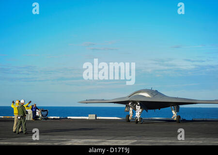 The X-47B Unmanned Combat Air System taxies on the flight deck of the aircraft carrier USS Harry S. Truman underway - Stock Photo