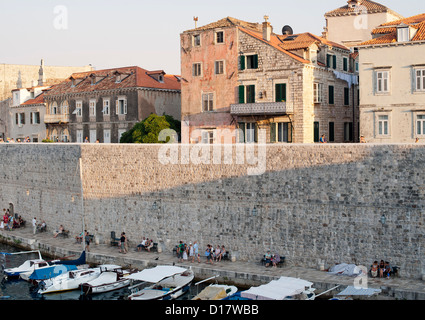 Part of the old harbour and walls of the old town of Dubrovnik on the Adriatic coast of Croatia. - Stock Photo