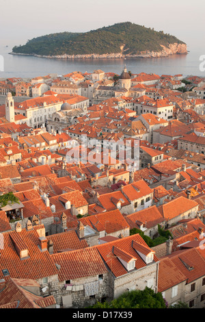 View over the rooftops of the old town in the city of Dubrovnik on the Adriatic coast of Croatia. Also visible is - Stock Photo